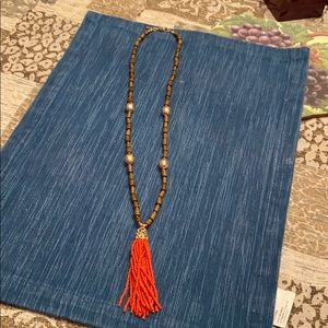 A orange tassel wooden bead long necklace